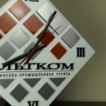 Часы в виде логотипа для корпорации Альтком